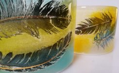 Feathers in glass